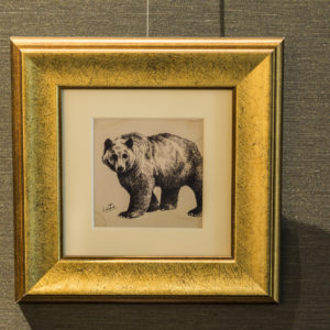 A bear drawn using fine ink strokes.