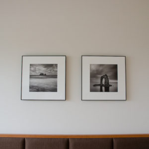 Photographs on the wall at 1 bedroom deluxe resort side
