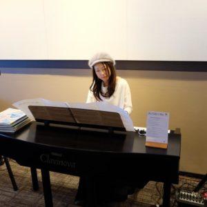 Emi Metcalf on piano.
