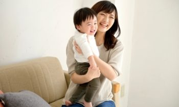 Woman holding a baby free stock