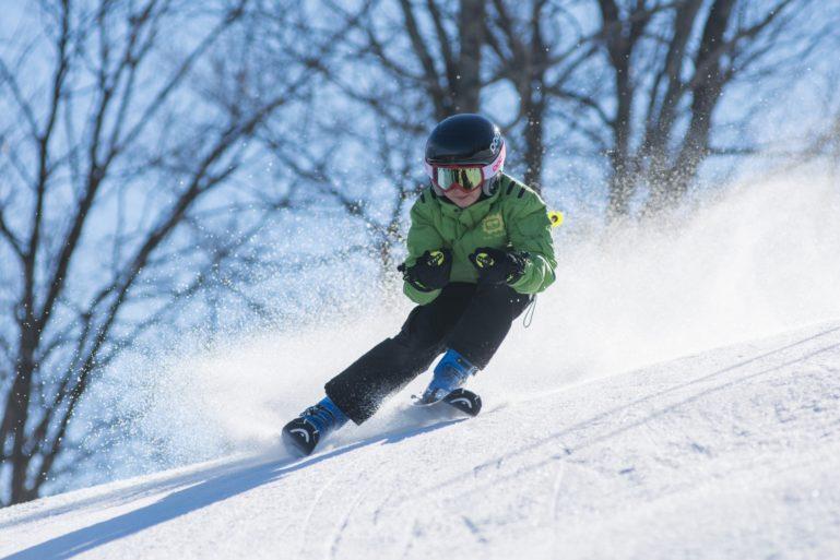 Kid skiing in spring